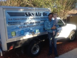 Sky Air LLC owner posing in front of company truck